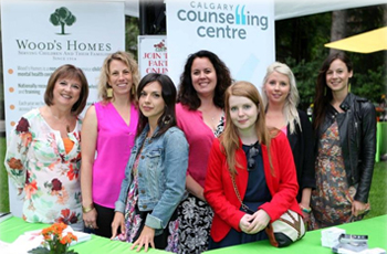 Staff members from the four non-profit organizations chosen to be a part of Brett Wilsons 2014 Garden Party